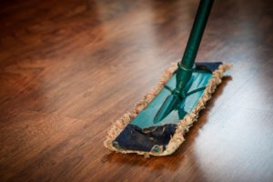 Mopping a wood floor.